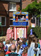 Punch & Judy show in Church Gate Gardens
