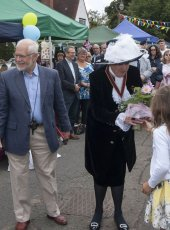 The High Sheriff of Surrey is presented with a bouquet of flowers