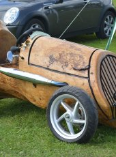 Remarkable model car made from a tree trunk!